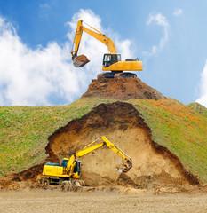 Excavators digging big hole.