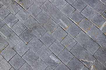 Pavement made of grey granite paving stones
