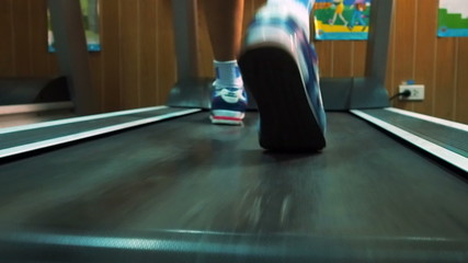 Exercising in the gym,Man walking on treadmill.60 fps.