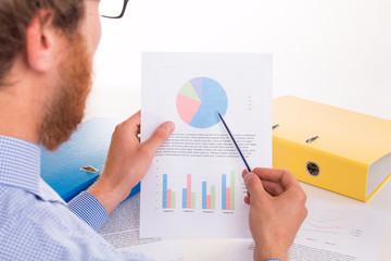 Employee examines corporate documents