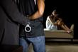 Cop arresting a man for domestic violence
