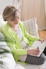 Woman writing in agenda