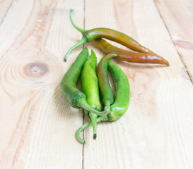 chili pepper isolated on wooden
