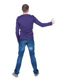 Back view of  man in t-shirt. shows thumbs up.