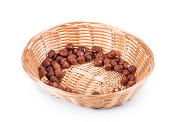 Hazel nuts on a wicker basket.
