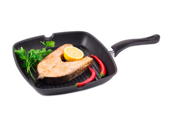 Frying pan with salmon steak.