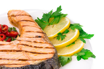 Fresh grilled salmon steak with lemon.