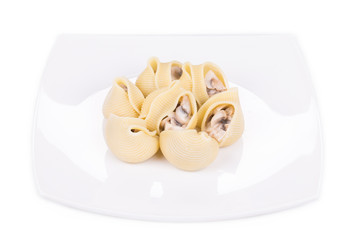 Pasta shells on stuffed with mushrooms.
