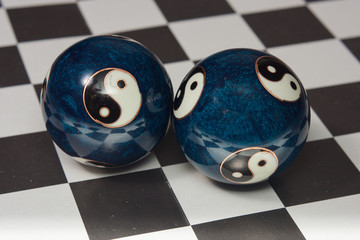 Chines meditation Balls on checkers table