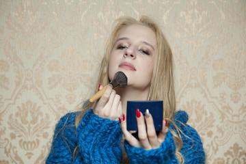 young beautiful woman applied powder