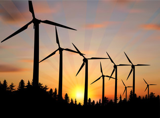 landscape with wind power generators at sunset