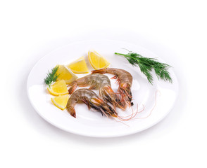 Raw shrimps on plate with lemon
