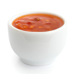 Sweet chilli sauce in small white dish.