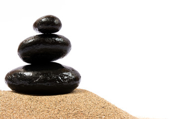 Relaxing on the beach, black stones on white background