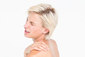 Suffering woman touching her shoulder