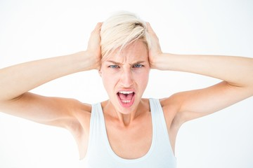 Angry woman screaming and holding her head