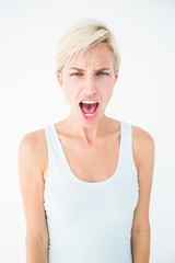 Angry blonde woman screaming