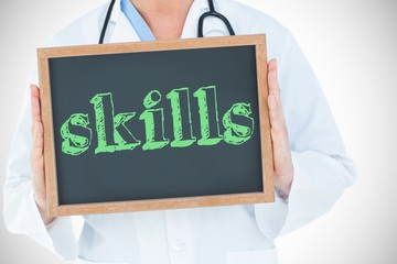 Skills against doctor showing chalkboard