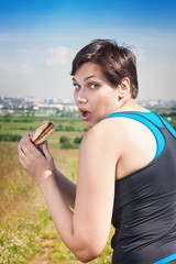 itness beautiful plus size woman stealthily eating junk food