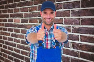happy male repairman gesturing thumbs up