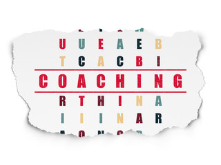 Education concept: word Coaching in solving Crossword Puzzle