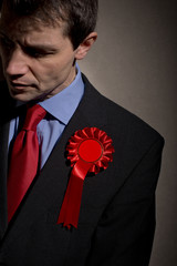 Unhappy Election Candidate With Red Rosette