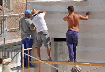 Team of bricklayers working