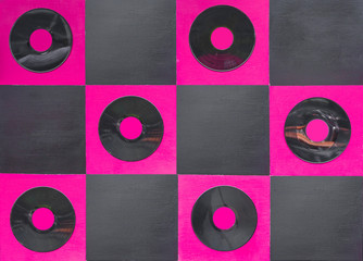 pink and black color paint with center gramophone record on squa