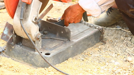worker cutting steel for house building