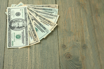 money on wood background