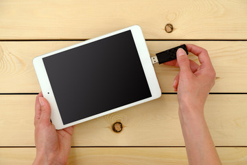 Hand Inserting usb memory stick in tablet