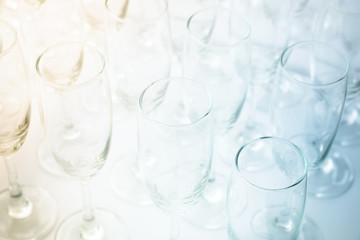 Two tone color wine glasses background.