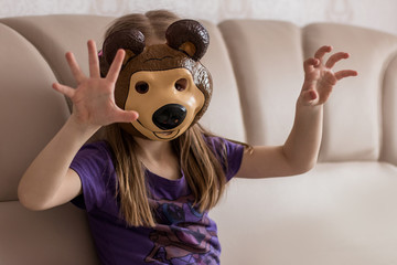The child in a bear mask