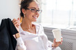 Smiling young woman in glasses with the cup of coffee or tea her - 81707844