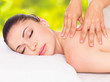 Woman having massage of body in nature spa