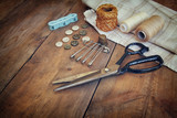 Fototapety Vintage Background with sewing tools and sewing kit over wooden
