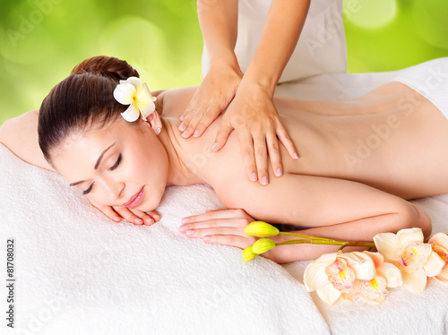 Woman having massage of body in nature spa - 81708032