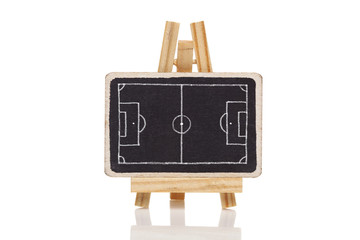 Бlackboard with a drawing of a blank Football field