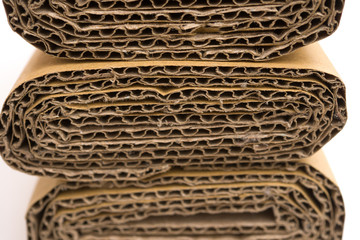 cross sections of folded corrugated cardboard
