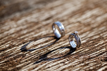wedding ring on the wooden background
