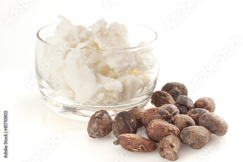 Keuken foto achterwand Planten shea nuts near butter on white background