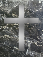 Silbernes Kreuz auf schwarzem Marmor