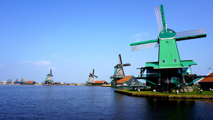 Windmills and river in holland