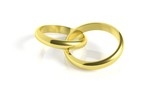 Pair of gold wedding rings, isolated on white