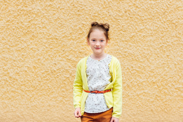 Fashion portrait of a cute little girl of 7 years old