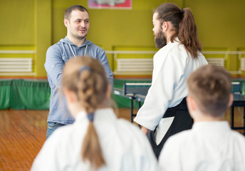 Kids father talking to aikido instructor