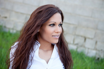 Brunette cool girl with brackets outside