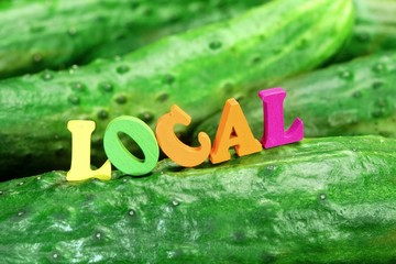 Wooden Sign Local On Fresh Home Grown Cucumbers