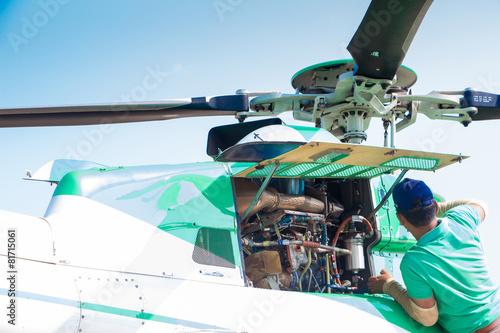 Leinwanddruck Bild Engineer maintaining a helicopter Engine