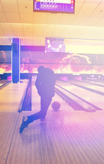 teen boy play the bowling